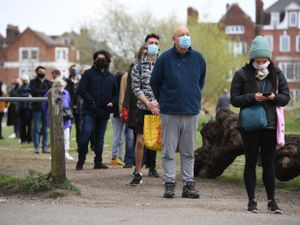 People stand in line for coronavirus surge testing on Clapham Common, south London (Kirsty O'Connor/PA)