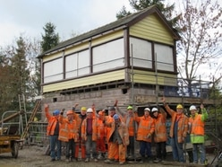 Historic signal box lifted into new home