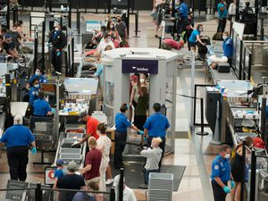 Travellers wear face coverings in the main terminal of Denver International Airport