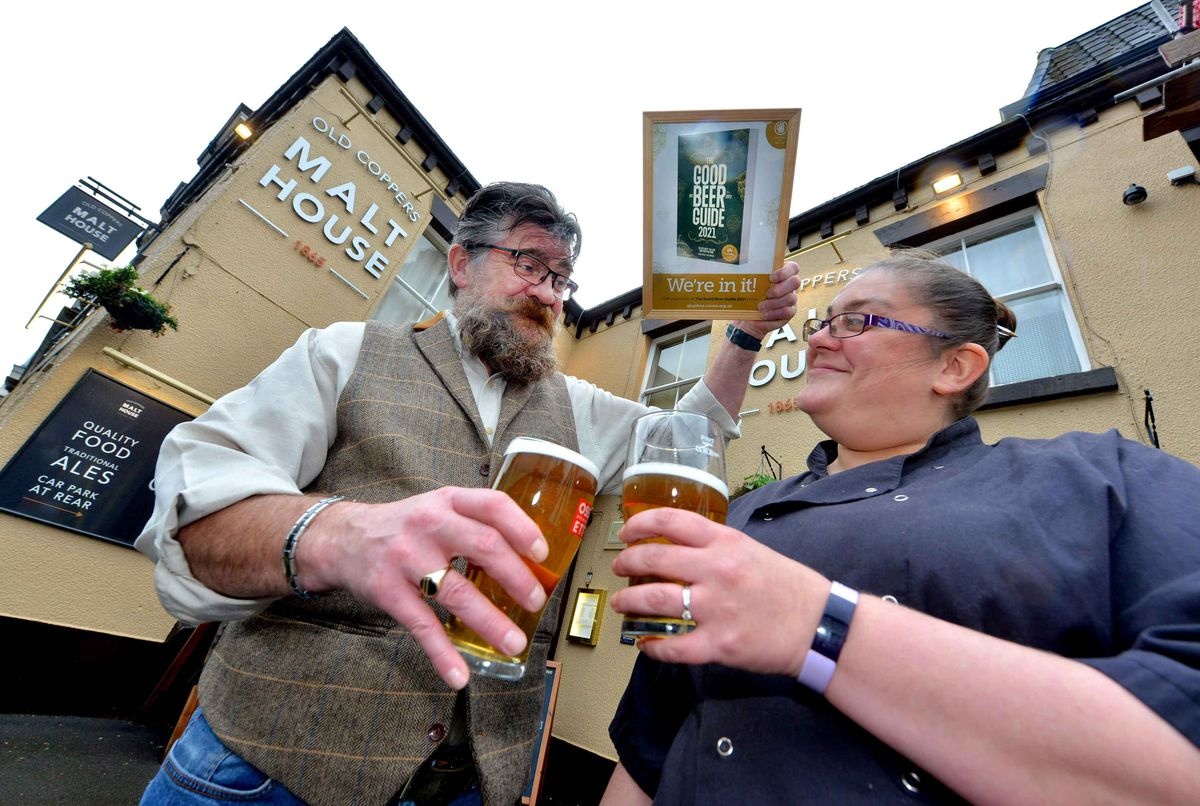 BORDER COPYRIGHT SHROPSHIRE STAR STEVE LEATH 29/10/2020..Pics in Church Stretton at pub: Old Coppers Malt House, celebrating after getting into the Good Beer Guide. Landlords: Heather Wheway and Philip Cole are pictured..