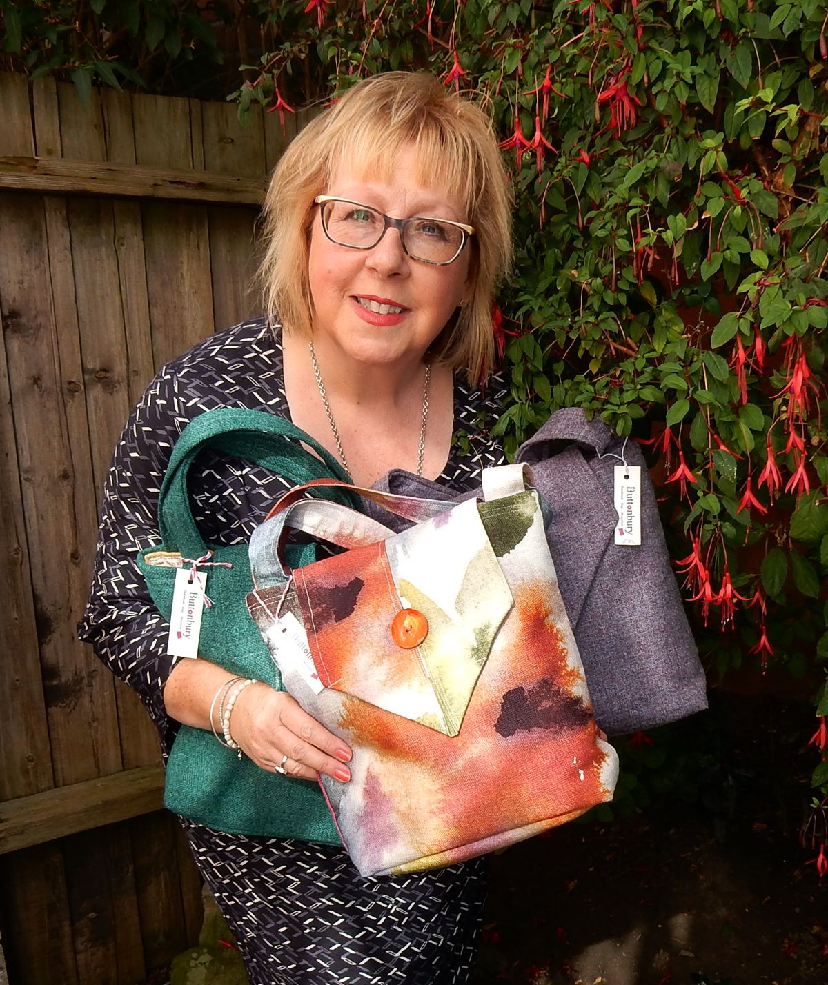 Sandra with some of her bags
