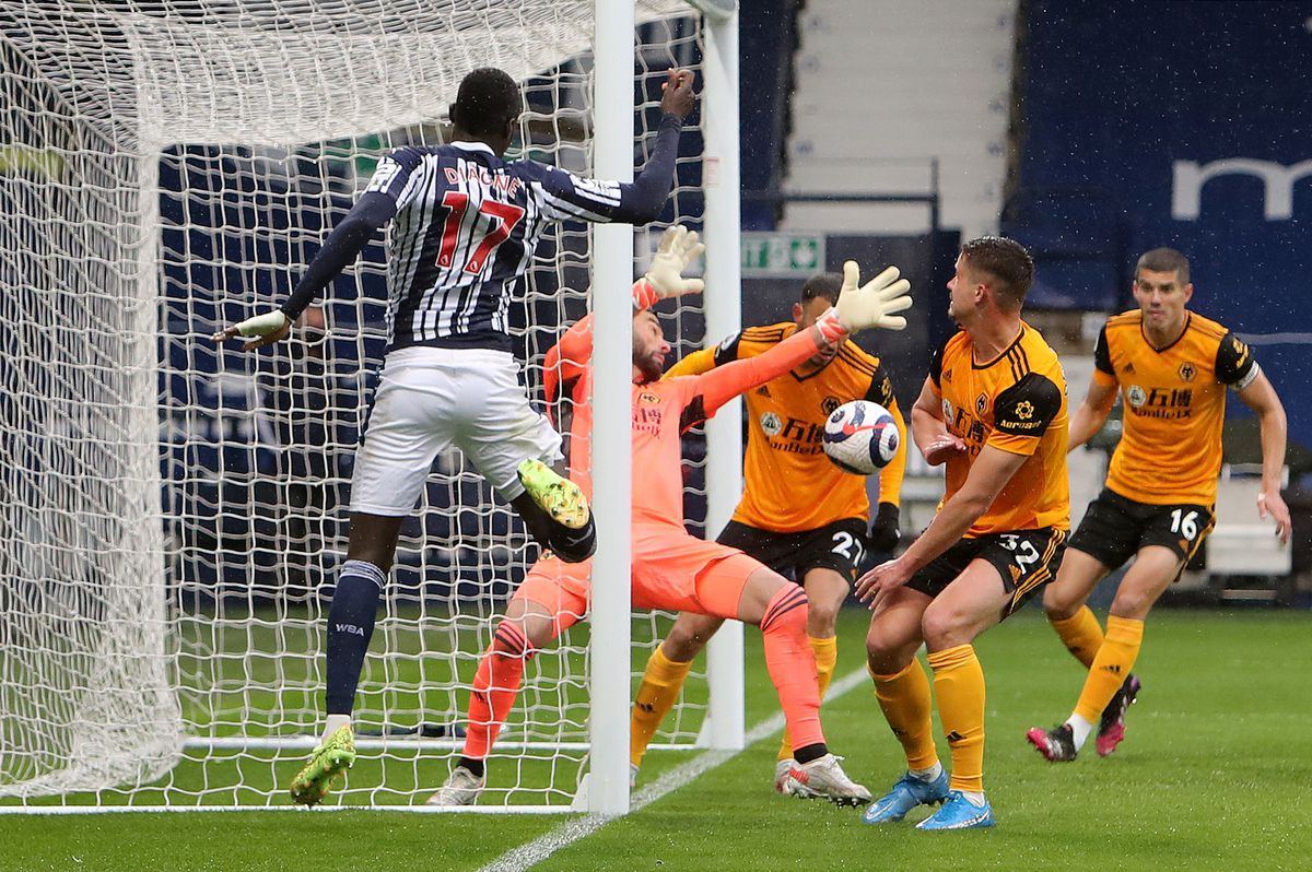 "West Bromwich Albion's Mbaye Diagne sees his shot saved by Wolverhampton Wanderers goalkeeper Rui Patricio during the Premier League match at The Hawthorns, West Bromwich. Issue date: Monday May 3, 2021. PA Photo. See PA story SOCCER West Brom. Photo credit should read: Geoff Caddick/PA Wire. ..RESTRICTIONS: EDITORIAL USE ONLY No use with unauthorised audio, video, data, fixture lists, club/league logos or ""live"" services. Online in-match use limited to 120 images, no video emulation. No use in betting, games or single club/league/player publications.."