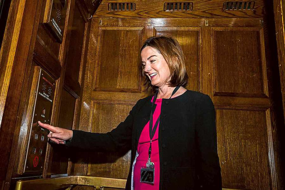 Lucy Allan takes the lift to her second floor office