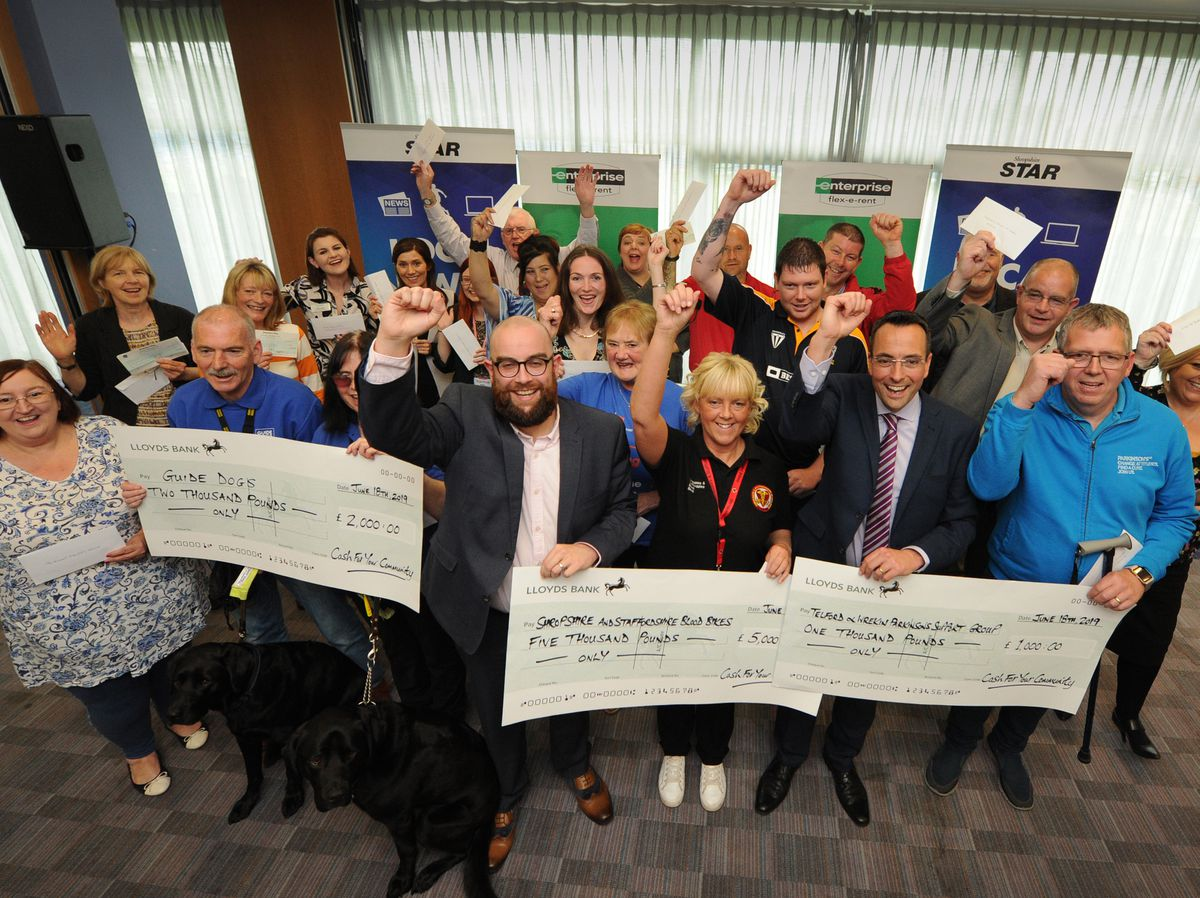 Winners with their cheques