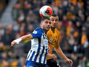 Brighton's Neal Maupay goes up againstWolves defender Romain Saiss in the lastmatch played before fans at Molineux in front of fans before the coronavirusrestrictions forced clubs to play theirgames behind closed doors last year (AMA)