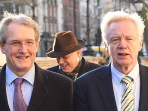 Fellow Brexiteer David Davis, right, has spoken of his support for Owen Paterson, left
