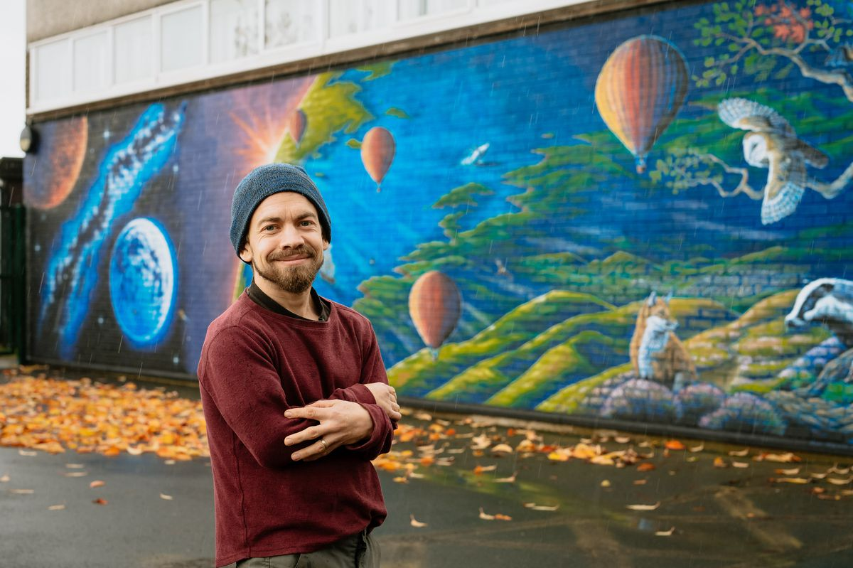 Rory McCann with his latest mural created in Church Stretton