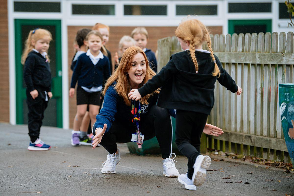 Ellie Madden with pupils at Much Wenlock Primary School