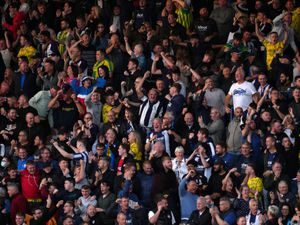 West Bromwich Albion fans in the stands celebrate