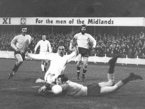 Jack Bentley slides in to score past Buxton keeper Davis for Telford United in March 1972