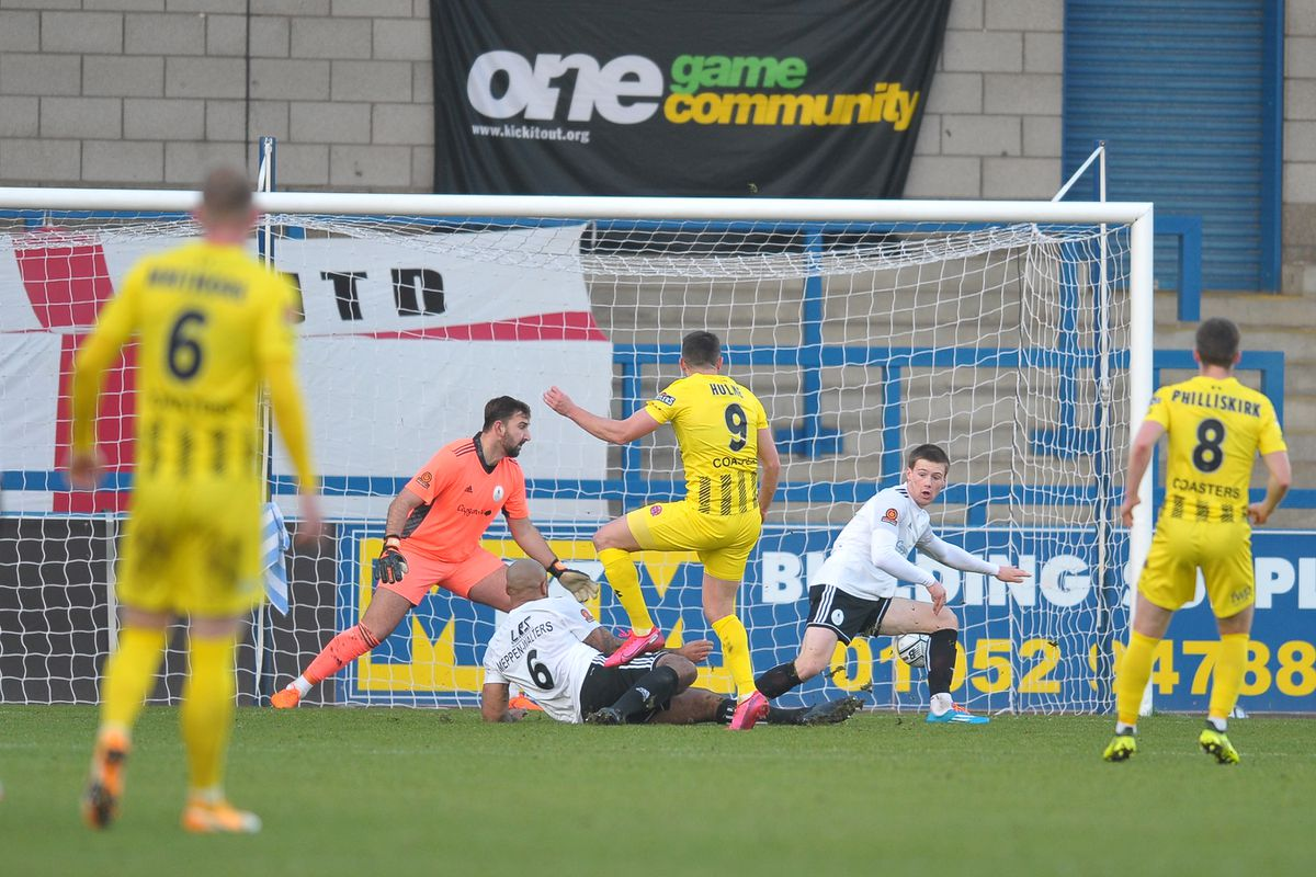 Fylde's Jordan Hulme scores