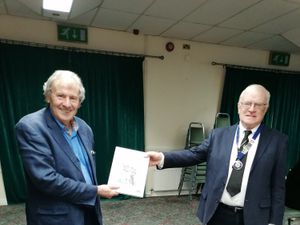 Graham Greasley presents Brian Colley with one of the books