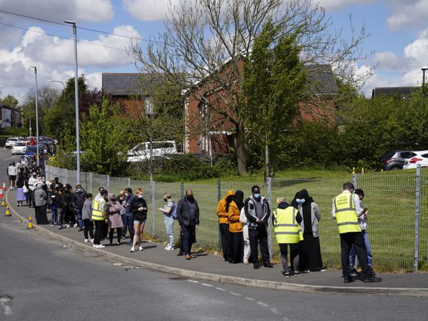 People queuing for Covid-19 vaccinations at the Essa academy in Bolton