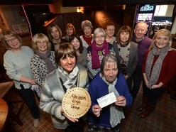 Crafters raise hundreds for dementia cafe