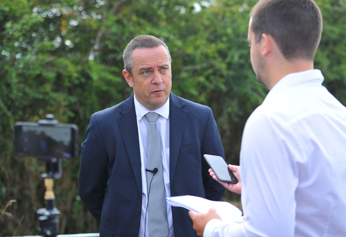 Detective Superintendent Tom Chisholm speaks to the press