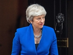 May calls for better homes as MPs warn house building target at risk