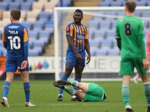James Roberts of Oxford City reacts on the floor after a challenge from Aaron Pierre of Shrewsbury Town which results in a red card for both players