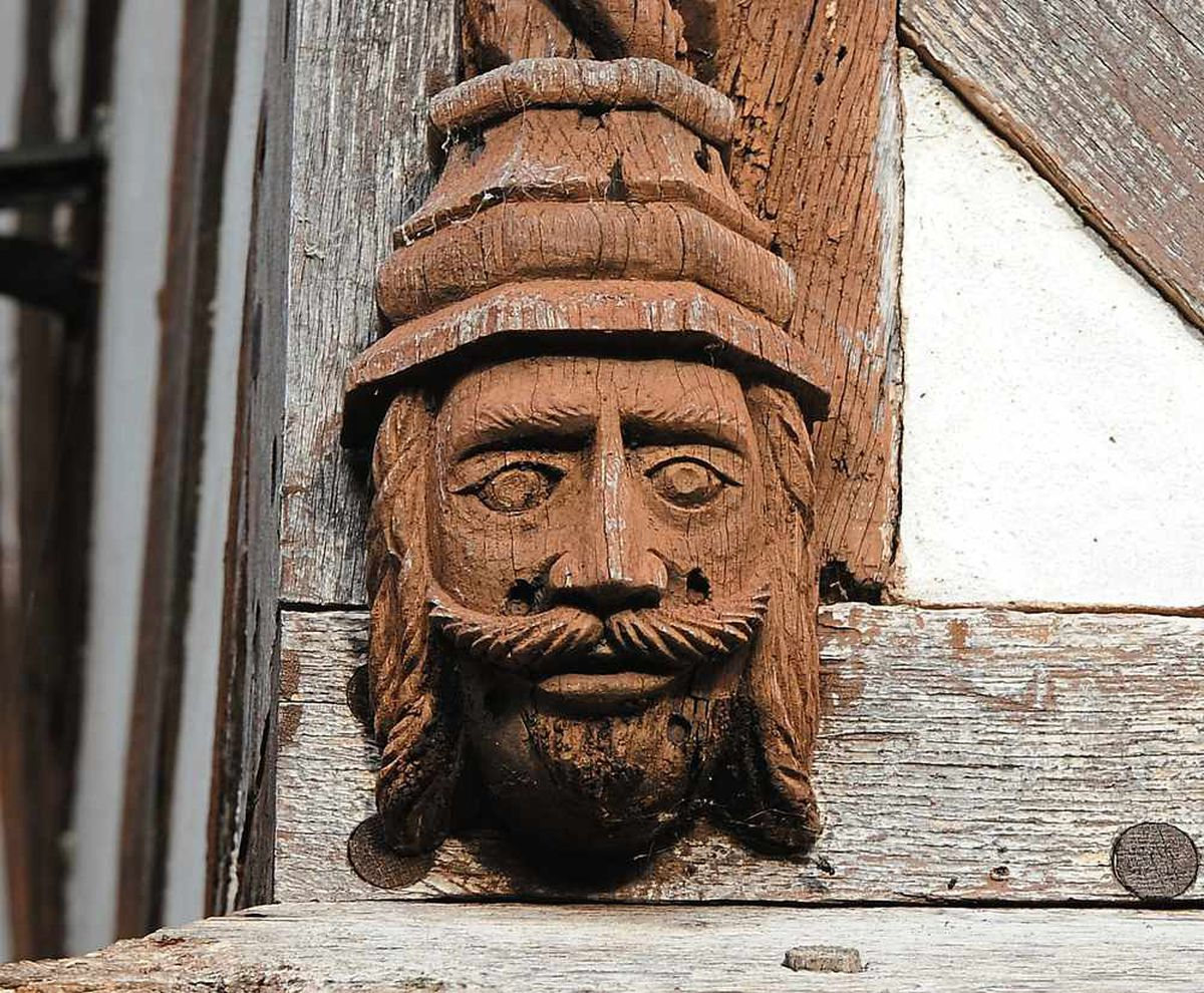 A carving of one of the men who built the hall