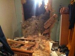 Boulder smashes through bedroom wall amid rockfall