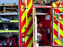 Crews tackle early morning garage fire