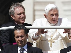 Pope Benedict XVI, right, arrives in St. Peter's square at the Vatican for a general audience as his then-butler Paolo Gabriele, bottom, and his personal secretary Georg Gaenswein sitting in the car with him (Alessandra Tarantino/AP)
