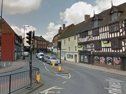 Shrewsbury road closed as man helped down from window ledge
