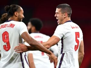 England's Conor Coady (right) celebrates scoring