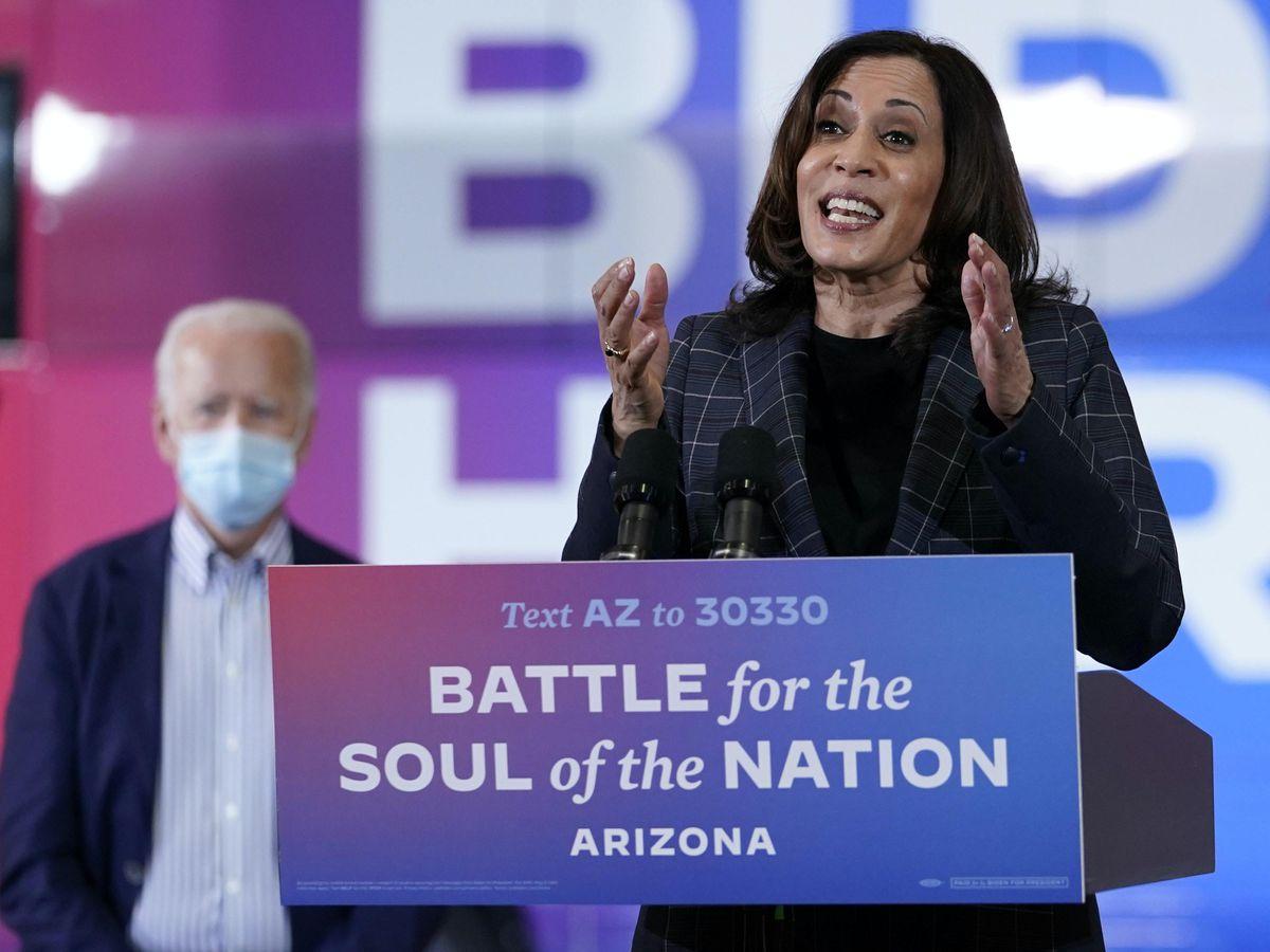 Democratic vice presidential candidate Senator Kamala Harris speaks while Joe Biden listens (Carolyn Kaster/AP)