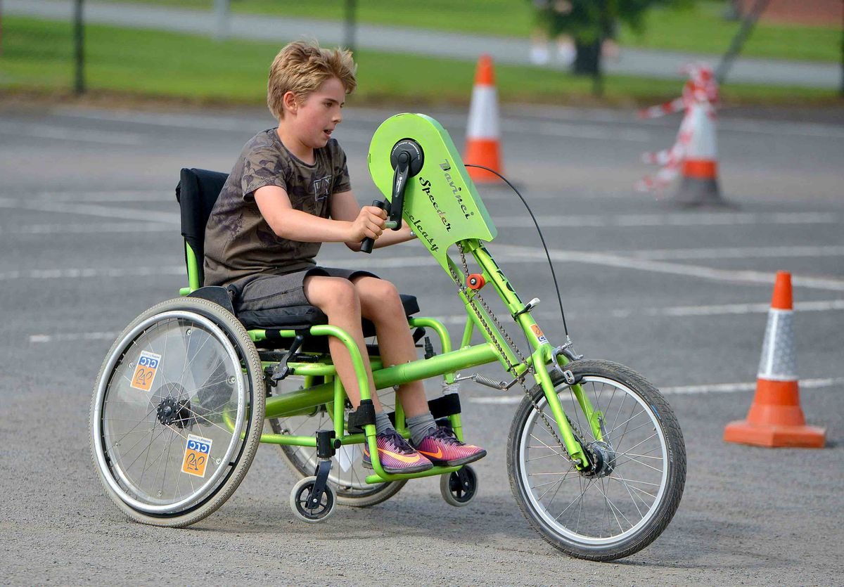 Ethan Lloyd 10 tries out one of the bikes