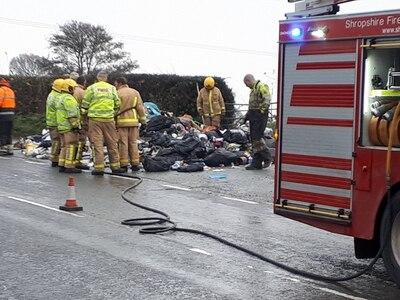 Bin lorry crew dumps burning load in lay-by near Oswestry
