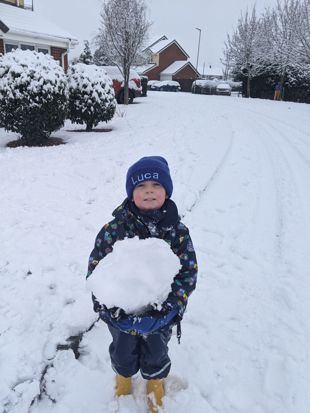 Luca Peter enjoying his first snow in Four Crosses, near Oswestry. Photo: Steve Peter