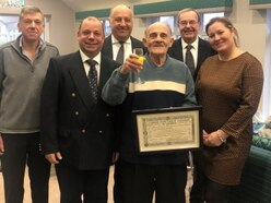 Mason Martin given certificate for 50 years' service