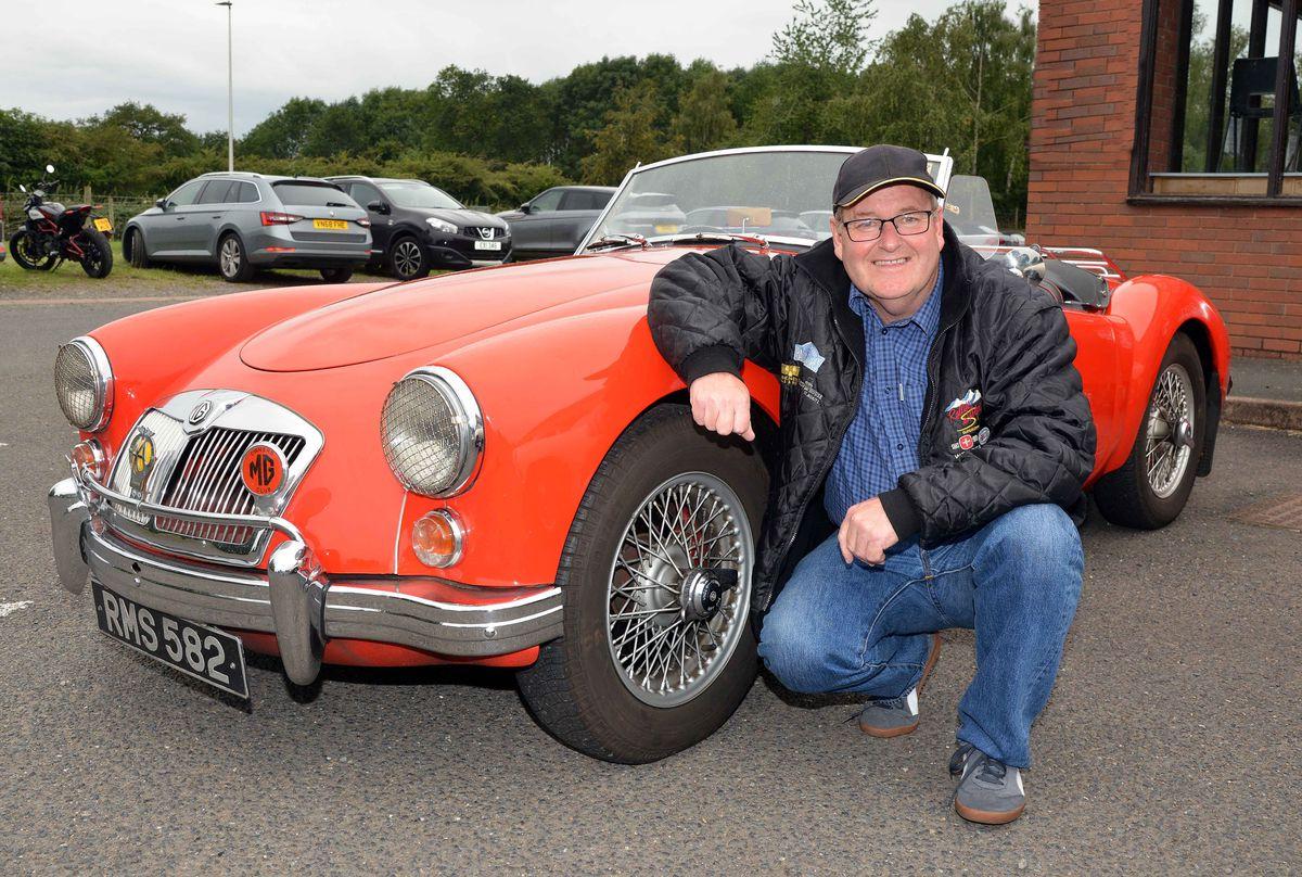 John Howarth in front of his 1960 MGA sports car
