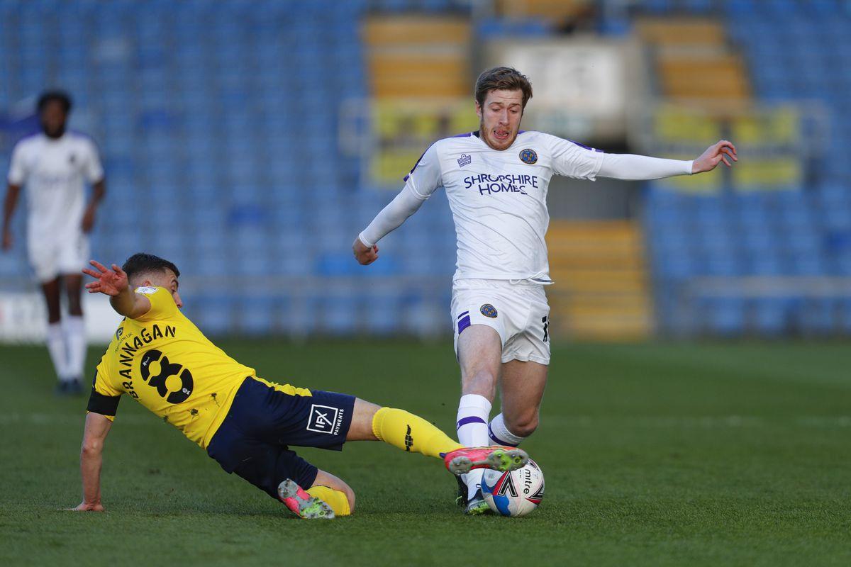 Cameron Brannagan of Oxford United and Josh Vela of Shrewsbury Town (AMA)