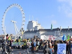 In Pictures: Climate change activists hold London bridge protests