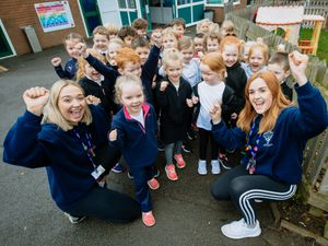 Molly Davis and Ellie Maden with pupils at Much Wenlock Primary School