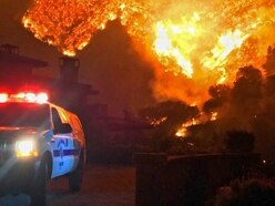 Crews begin to contain huge California wildfire