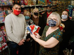 In Picture L>R: Harwinder Bhathar, Carole Roberts, Lynne Jones, Satnam Randwa, Lidia Wenlock and Susan O'Brien with the masks Susan made to raise money for the NHS