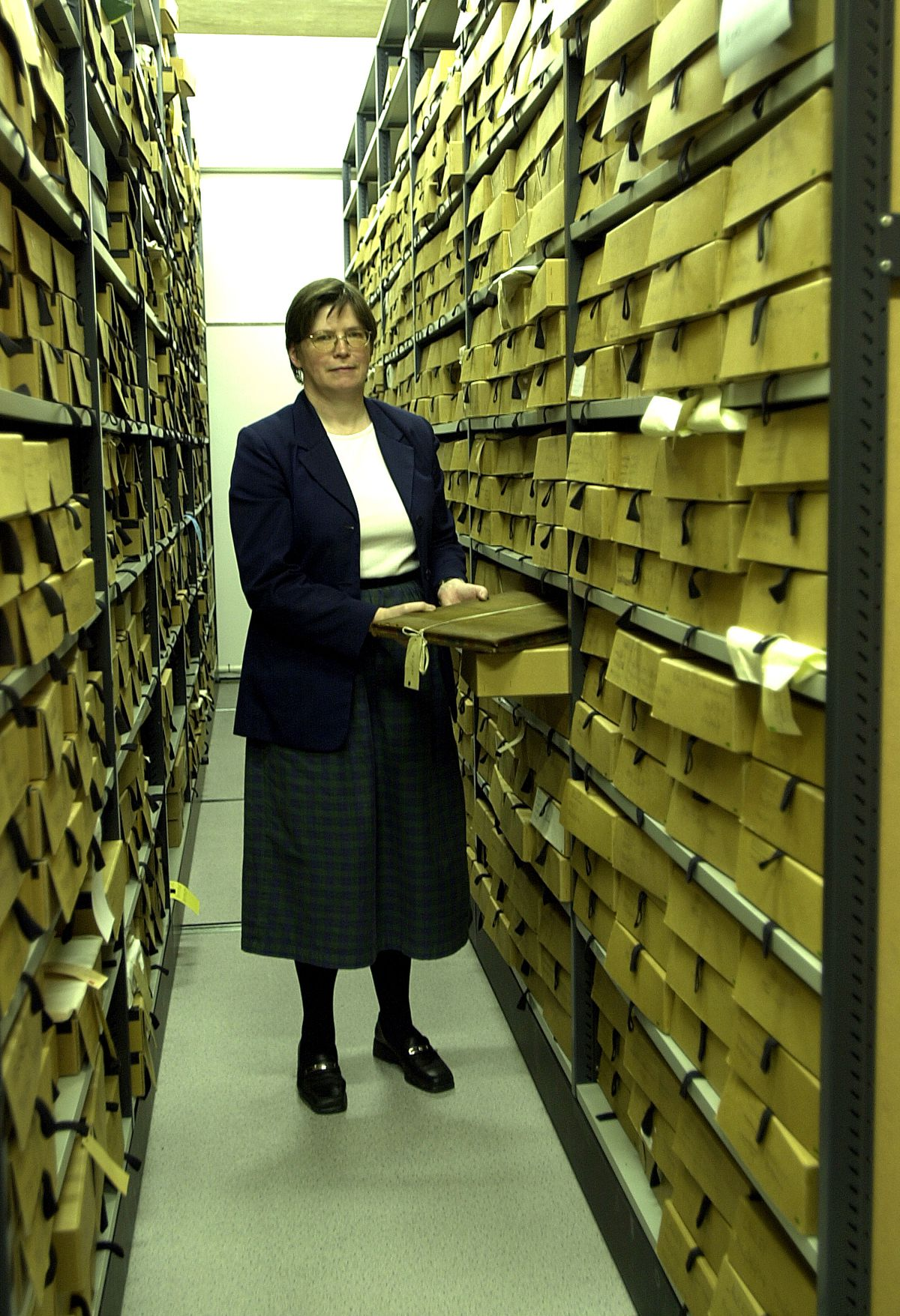 Mary among the archives in 2002.