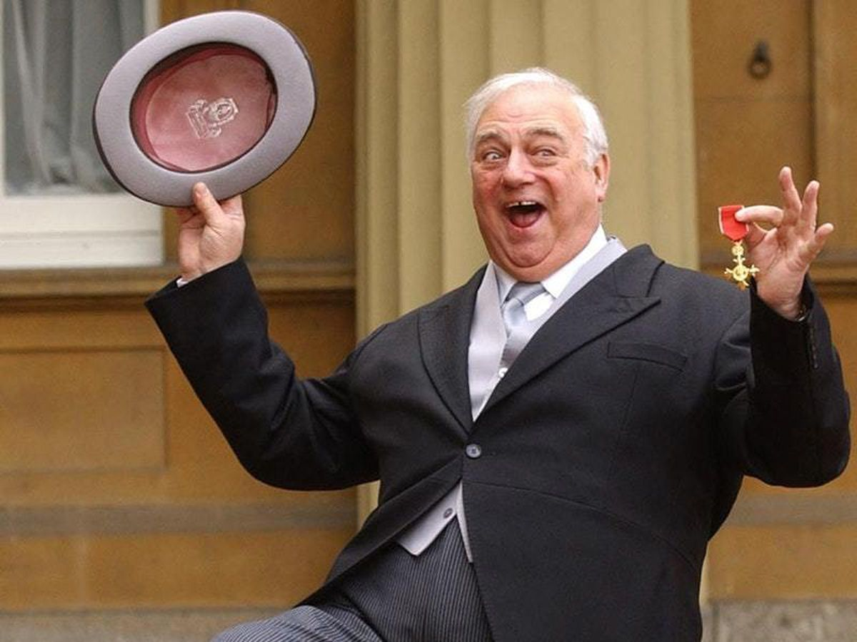 Roy Hudd holds his OBE