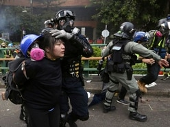 100 protesters surrounded by police at Hong Kong university