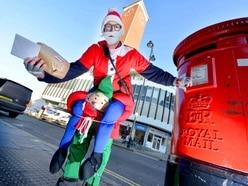 Jolly Shrewsbury postie turns into Santa