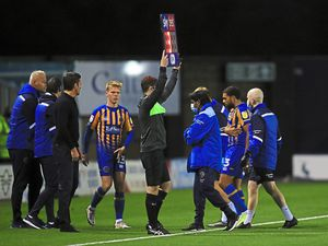 Scott Golbourne of Shrewsbury Town leaves the pitch injured (AMA)