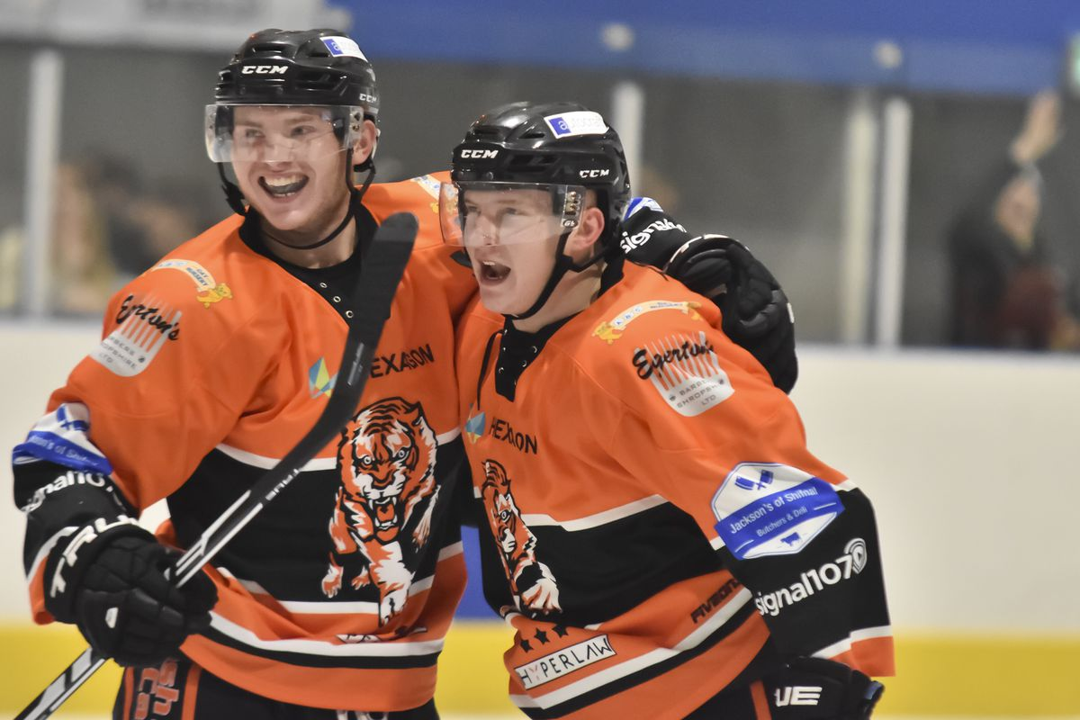 Telford Tigers in action against Peterbrough Phantoms (Photo: Steve Brodie) Corey Goodison, left, celebrates after Nick Oliver scores for Tigers