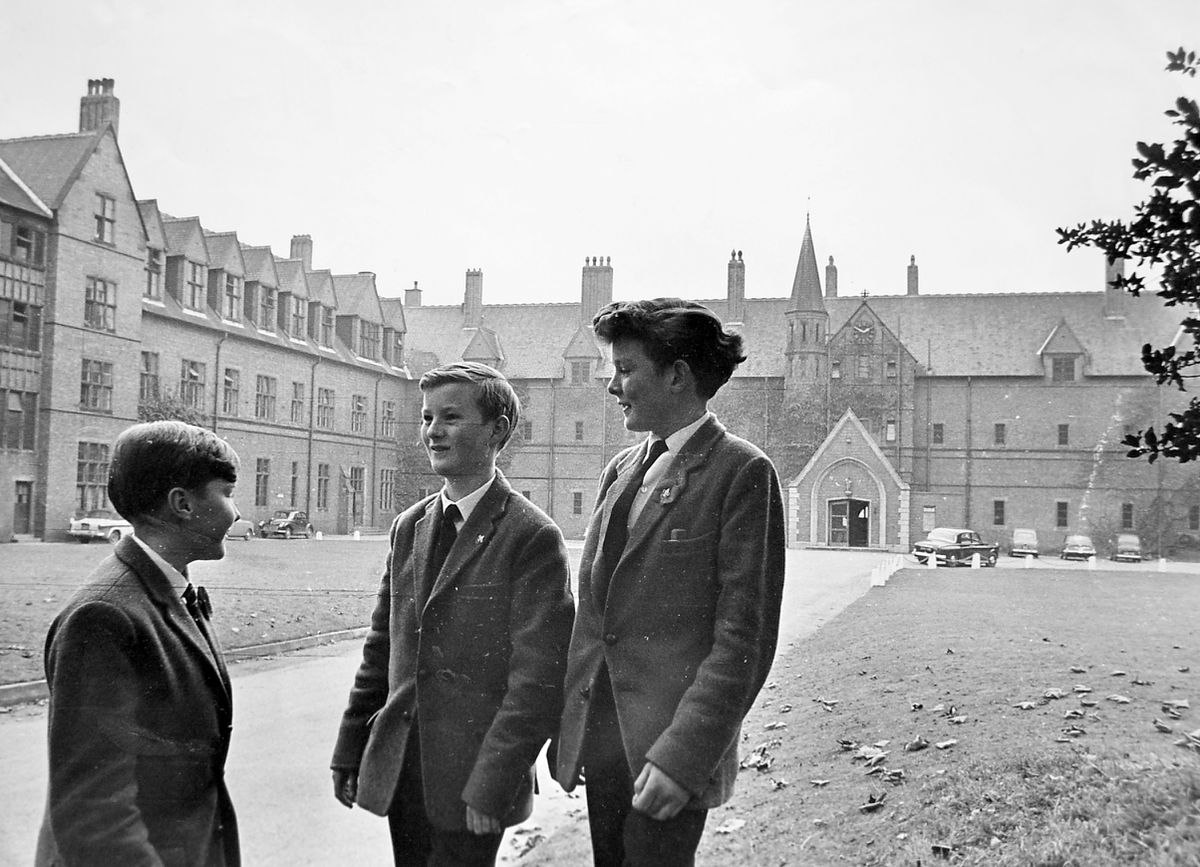 """Sadly we don't have the names of three lads who were at Ellesmere College back in November 1964, but we can tell you what the original caption said back then: """"Ellesmere College is the second public school to open its doors to boys whose parents are unable to afford the fees of independent boarding schools. The college is offering four places for boys in this category in 1965, which brings the total to 14 places for the two Shropshire public schools. Pictured above are three of today's pupils with the college in the background."""""""