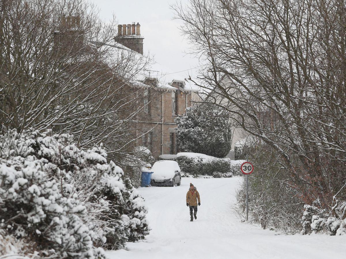 A pedestrian walks at Larbert, near Falkirk in Scotland