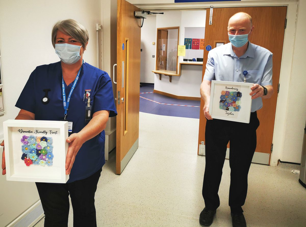 From left, Dawn Pugh, bone density scan (DXA) technologist; and Ian MacLennan, assistant chief nurse of the MSK Delivery Unit, with some of the dementia frames