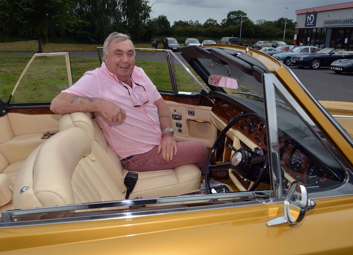 Lewis Price seen here smiling seated in his 1972 Rolls Royce Camargue