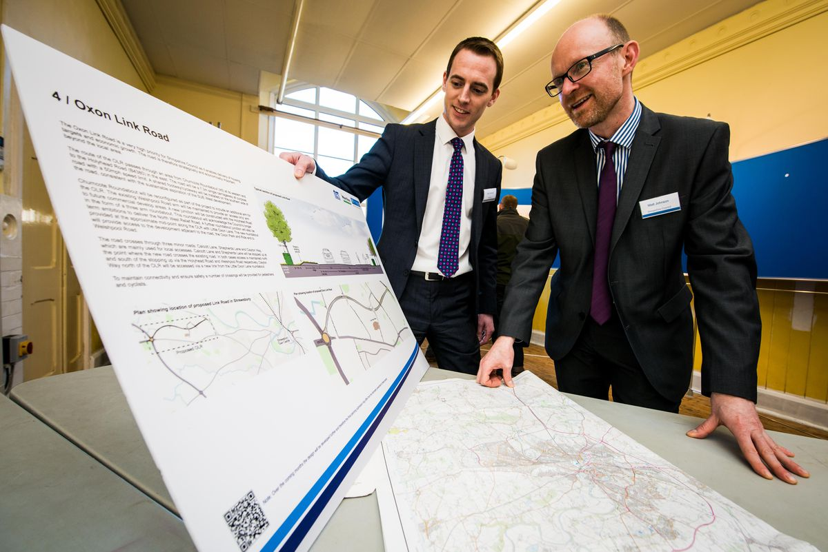 Shropshire Council officer Matt Johnson  right, with the Oxon Link Road plans