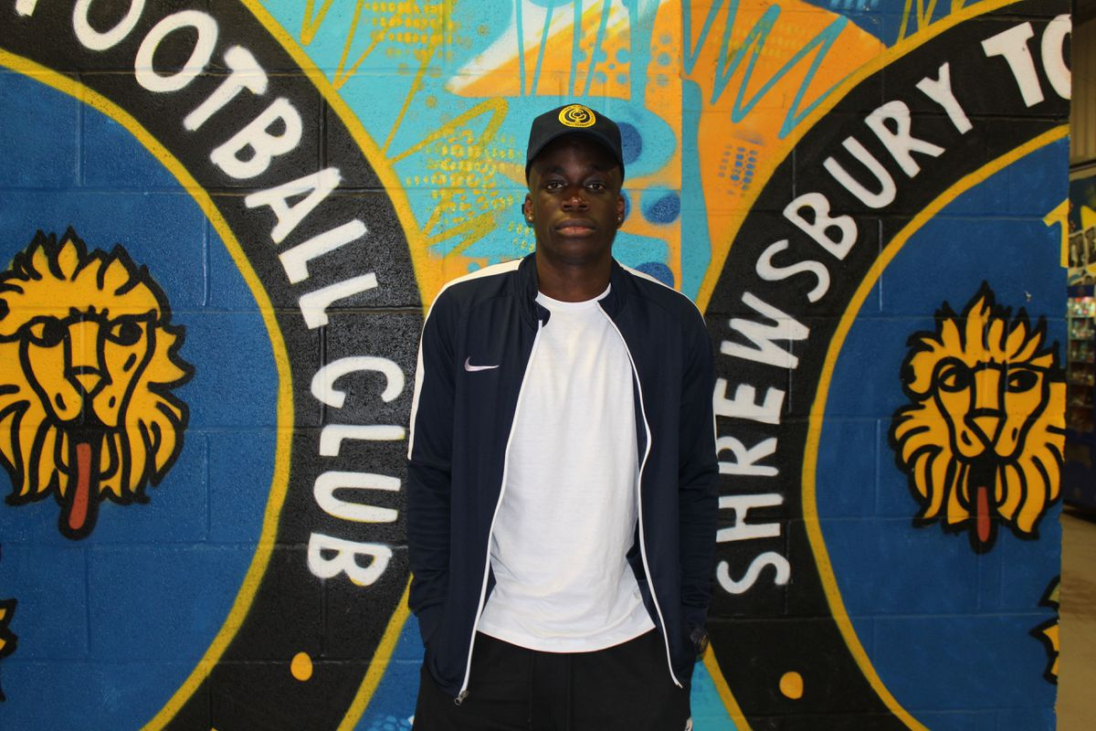 Arthur Gnahoua checks in as Shrewsbury's first new summer signing: Pic: Shrewsbury Town